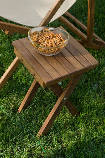 Scissor Leg Teak Shower Bench doubles as an outdoor table.