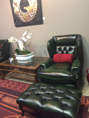 antique green leather wing back chair
