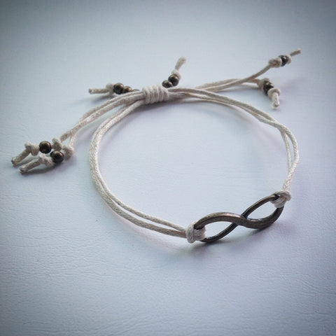 Adjustable sliding knot cord bracelet - beige with antique bronze infinity symbol and beads - eDgE dEsiGn London