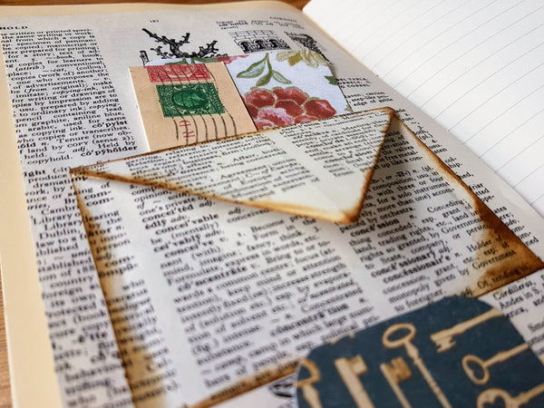 Hand made envelope from a vintage dictionary page inside a Bespoke Bindery Junk Journal
