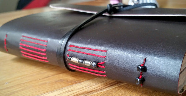 Dark Brown handmade leather journal with red long stitch and beaded spine