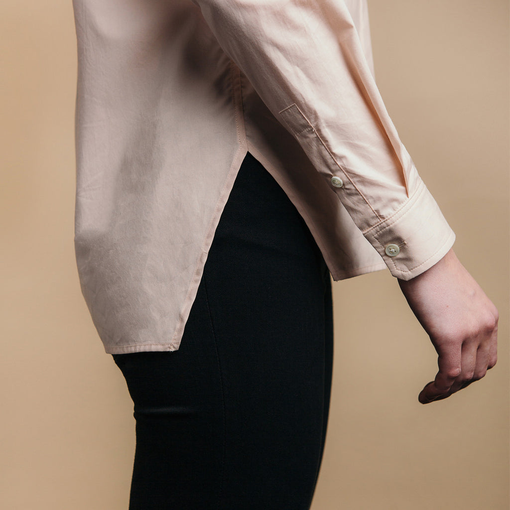 The Trapezoid Shirt - Dusty Blush. Side view, angled hem meets at point.