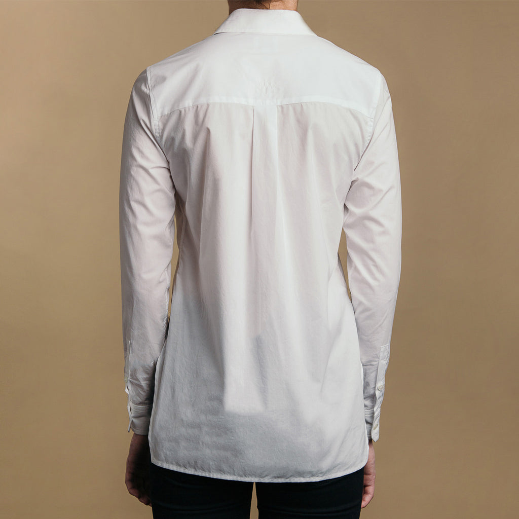 The Trapezoid Shirt - Paper White. Back view. Box pleat, straight hem.