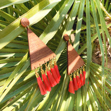 Load image into Gallery viewer, Big triangular wooden earrings on gold-plated base decorated with red raffia paper tassels