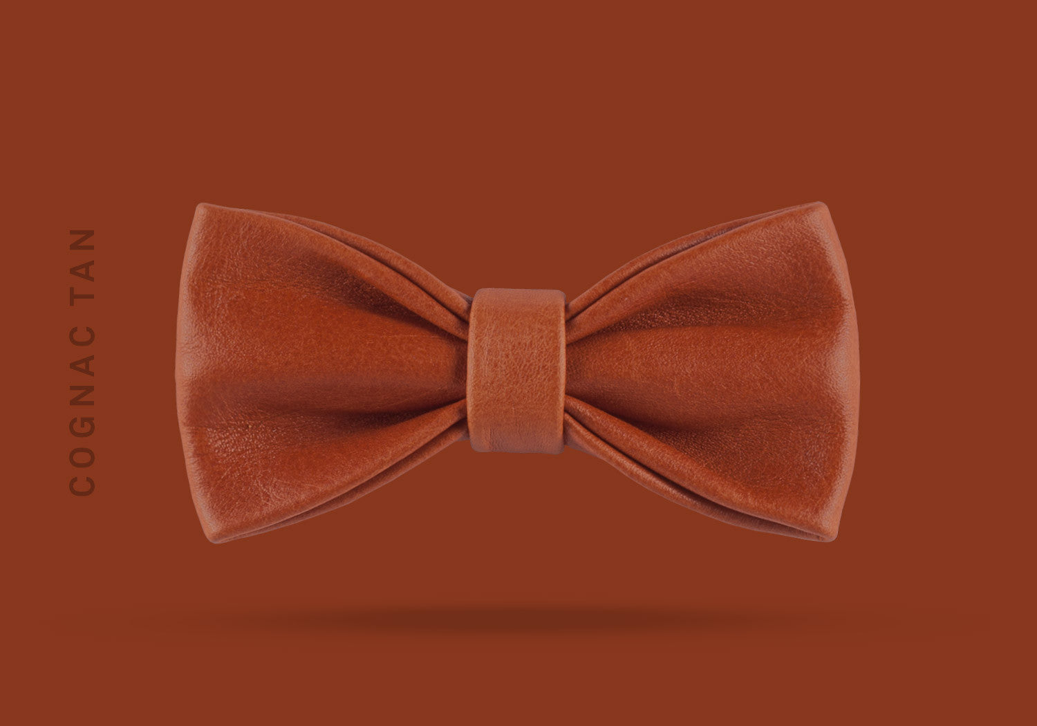 This cognac tan WEEF handmade leather bow is a great present or gift idea for dapper and stylish gentlemen for fathers day, valentines day or Christmas.