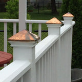 flat wood post cap with copper pyramid on deck railing posts