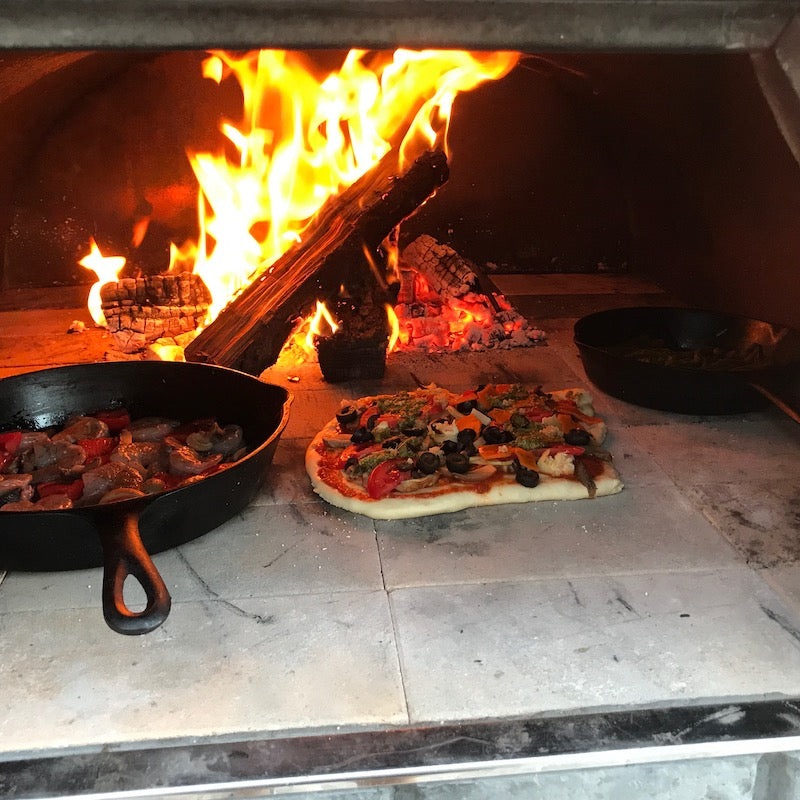 Pizza and Steak Cooked in Pizza Oven