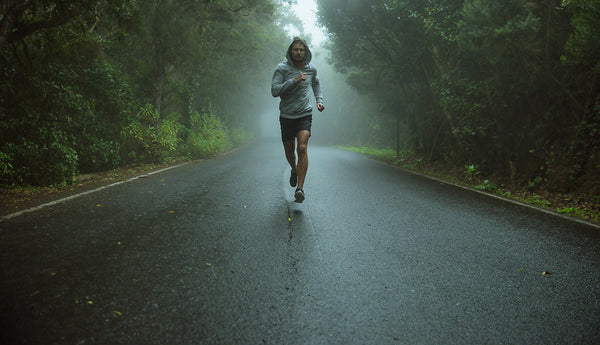 Athlete running in the rain on-road