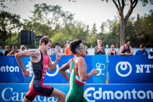 Two athlete runners racing to the finish line