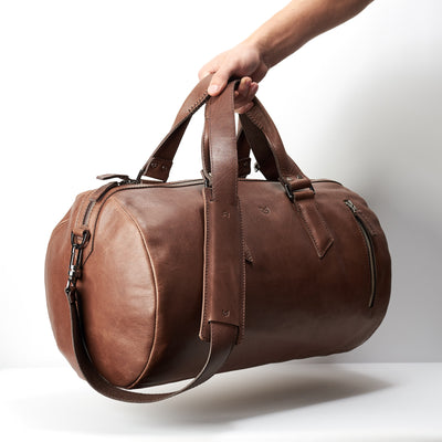 Style photo. Brown leather duffle bag for mens gifts. Shoulder gym bag