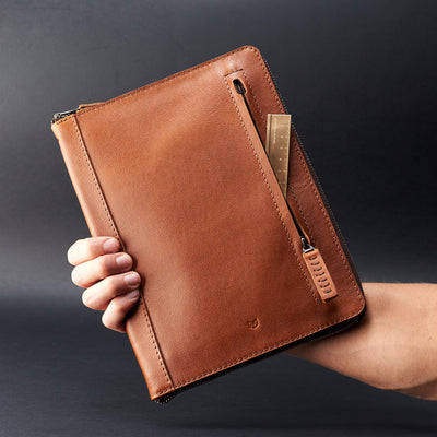 Holding hand. A5 leather notebook cover by Capra Leather. Gifts for artists.