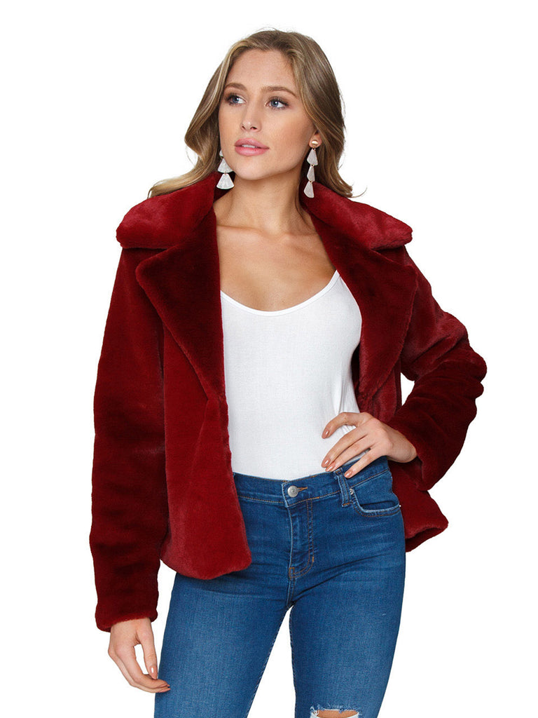 Girl wearing a jacket rental from MINKPINK called Lucia Off Shoulder Top