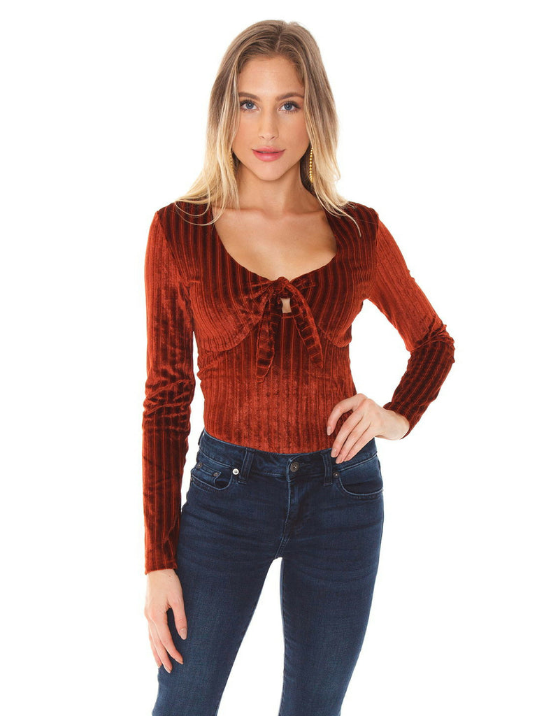Women wearing a bodysuit rental from MINKPINK called Lucia Off Shoulder Top