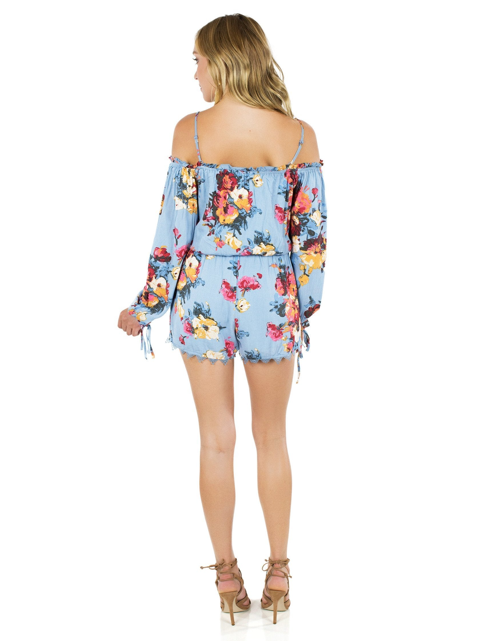 Women wearing a romper rental from FashionPass called Life Is Beautiful Romper