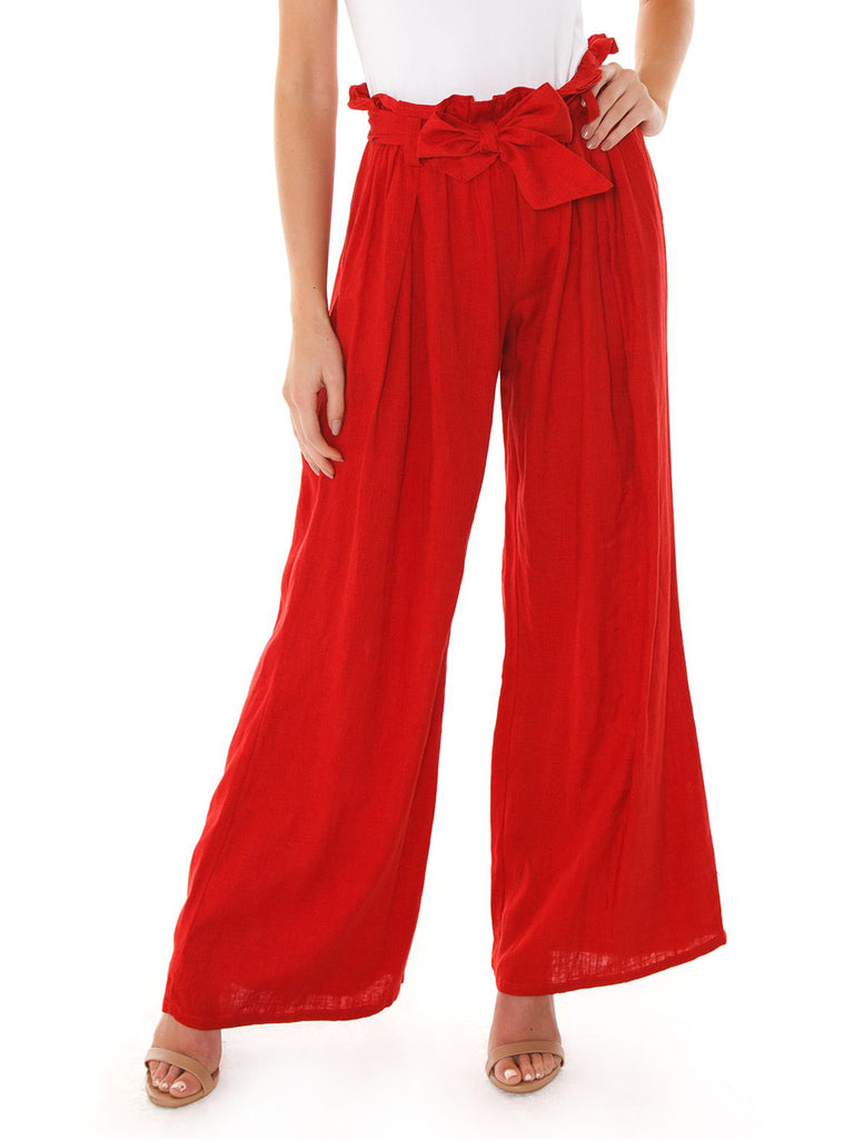 Woman wearing a pants rental from FashionPass called Jessie Jumpsuit