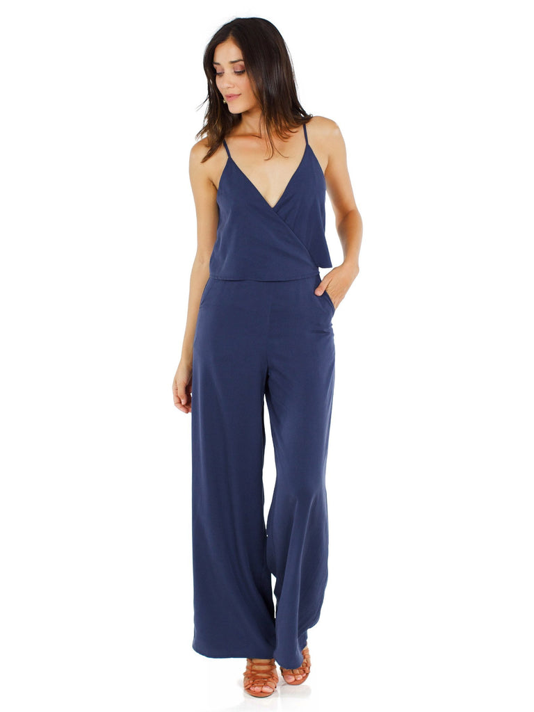 Girl outfit in a jumpsuit rental from Line & Dot called Brynn Deep Plunge Dress