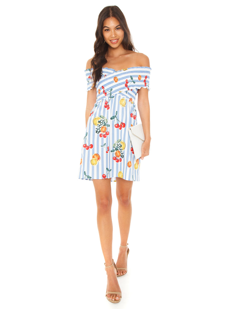 Woman wearing a dress rental from Show Me Your Mumu called Brynn Deep Plunge Dress