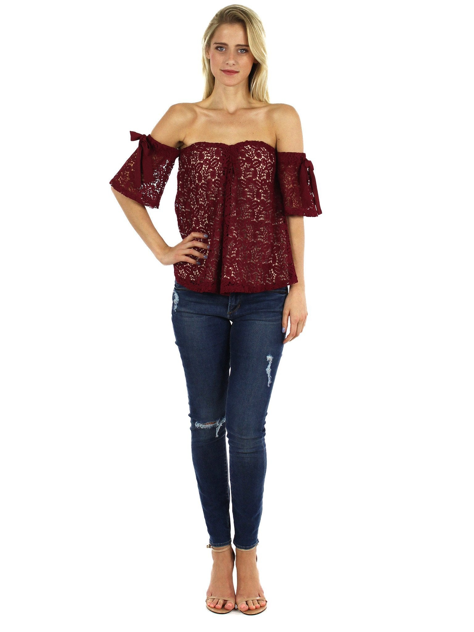 Women wearing a top rental from Moon River called Off Shoulder Lace Top