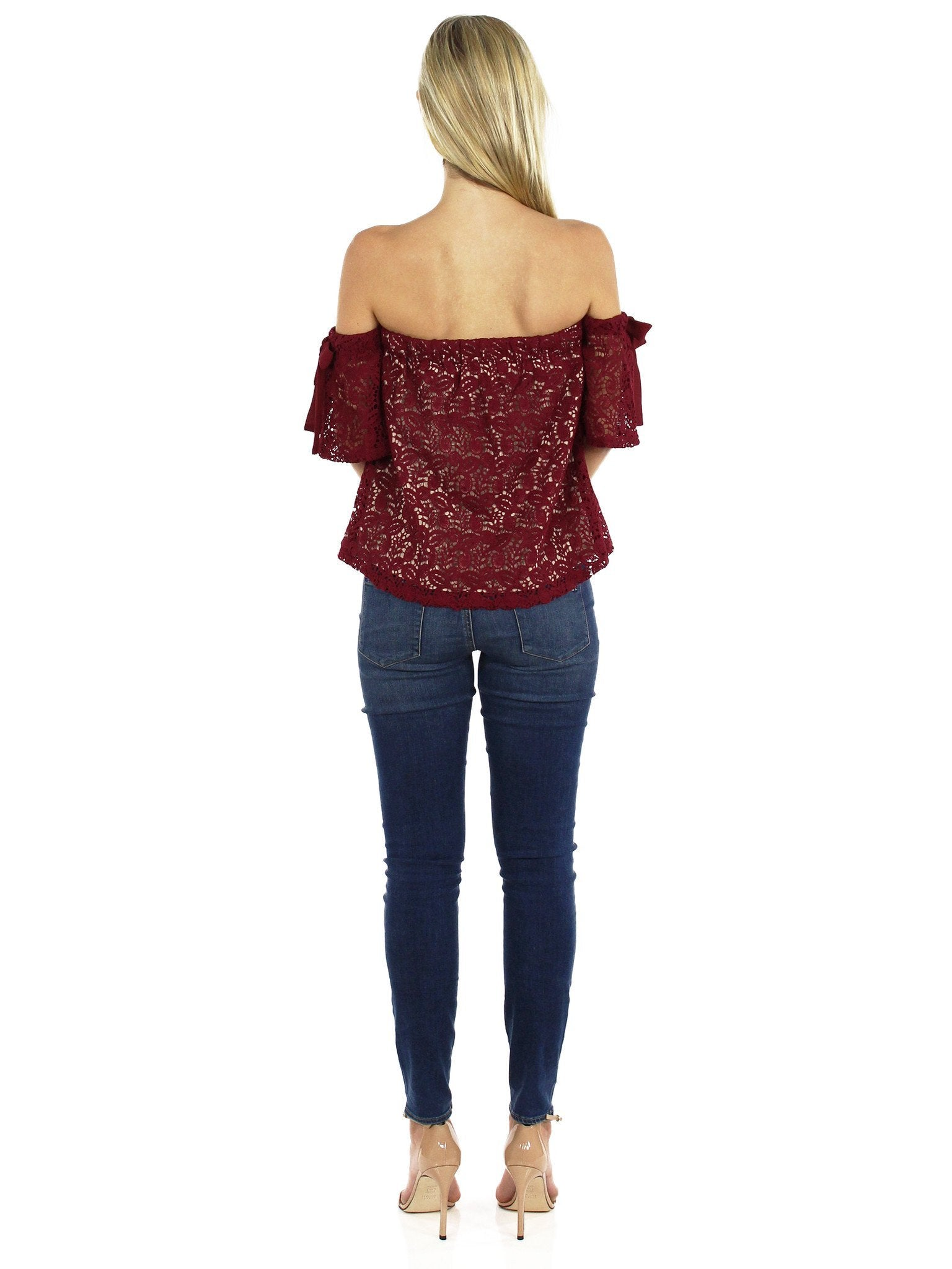 Girl wearing a top rental from Moon River called Off Shoulder Lace Top