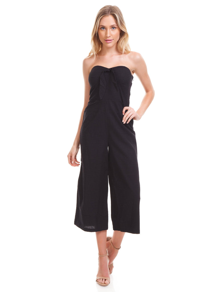 Girl wearing a jumpsuit rental from MINKPINK called Lucia Off Shoulder Top