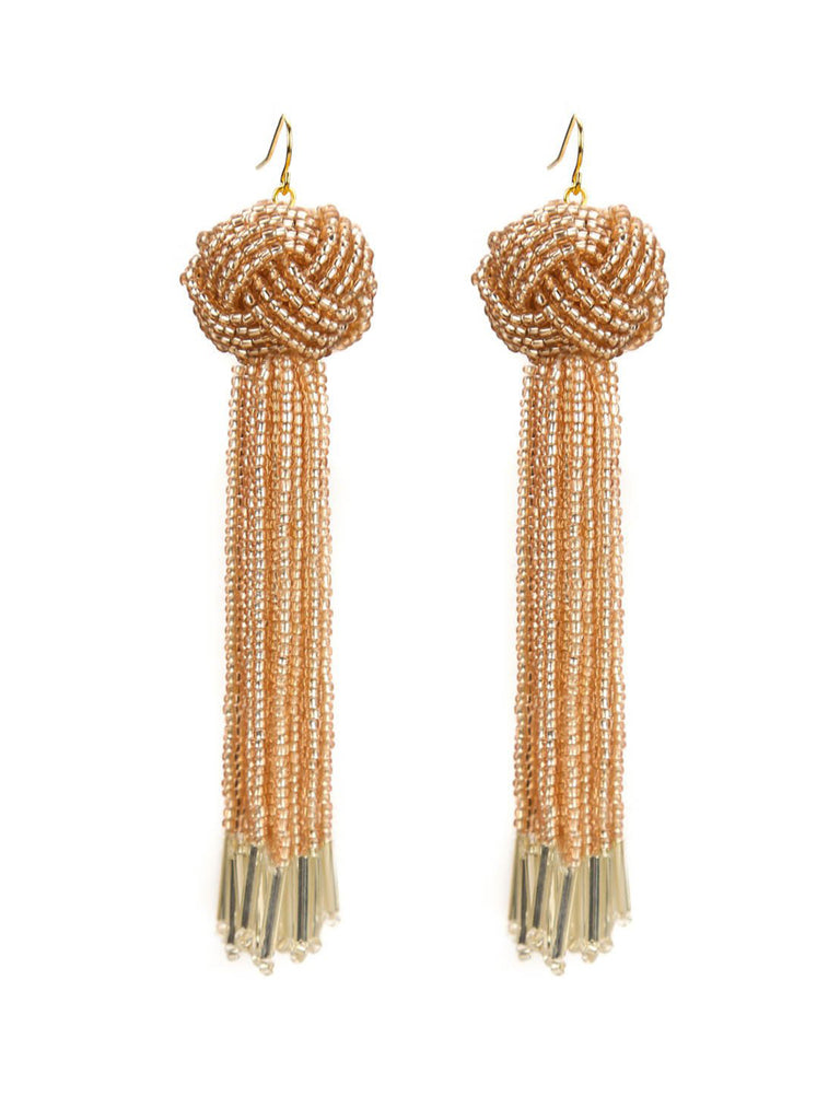 Women wearing a earrings rental from Vanessa Mooney called Natalia Tassel Earrings