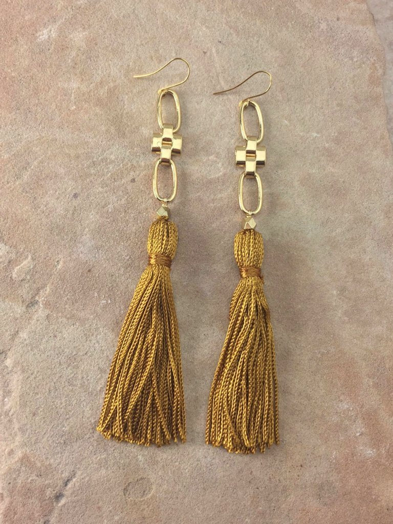 Women outfit in a earrings rental from Vanessa Mooney called Natalia Tassel Earrings