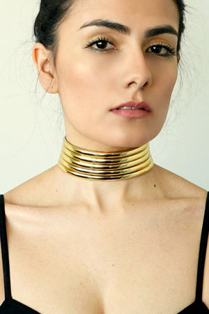 Close up of woman wearing Gold Ndebele Choker