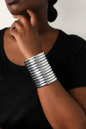 Close up of woman posing with the Silver Ndebele Cuff