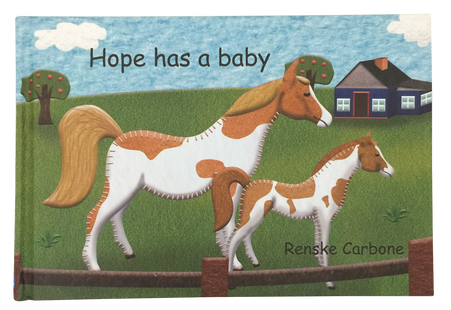 Hope has a baby book and felt toy