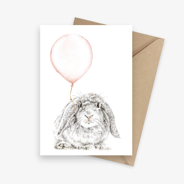 Birthday card featuring a lop-eared bunny with a pink balloon.