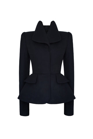 This sculptural suit jacket is fabricated in deep navy blue wool. It features a close fitting form for a structured silhouette, boasting a neat, tailored shoulder line. All of this is perfectly set off by a strong shoulder, achieved with our own hand-crafted shoulder pads, designed to be both comfortable and flattering.