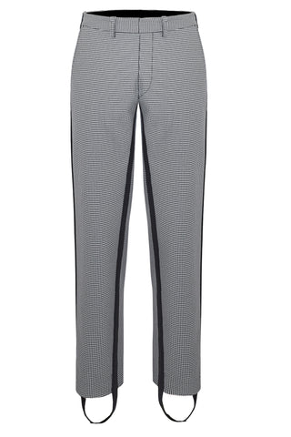 """Pipe"" is a neat, formal, slim leg pant fabricated in a black and white dogtooth. A black side stripe extends down past the hem into an adjustable stirrup."