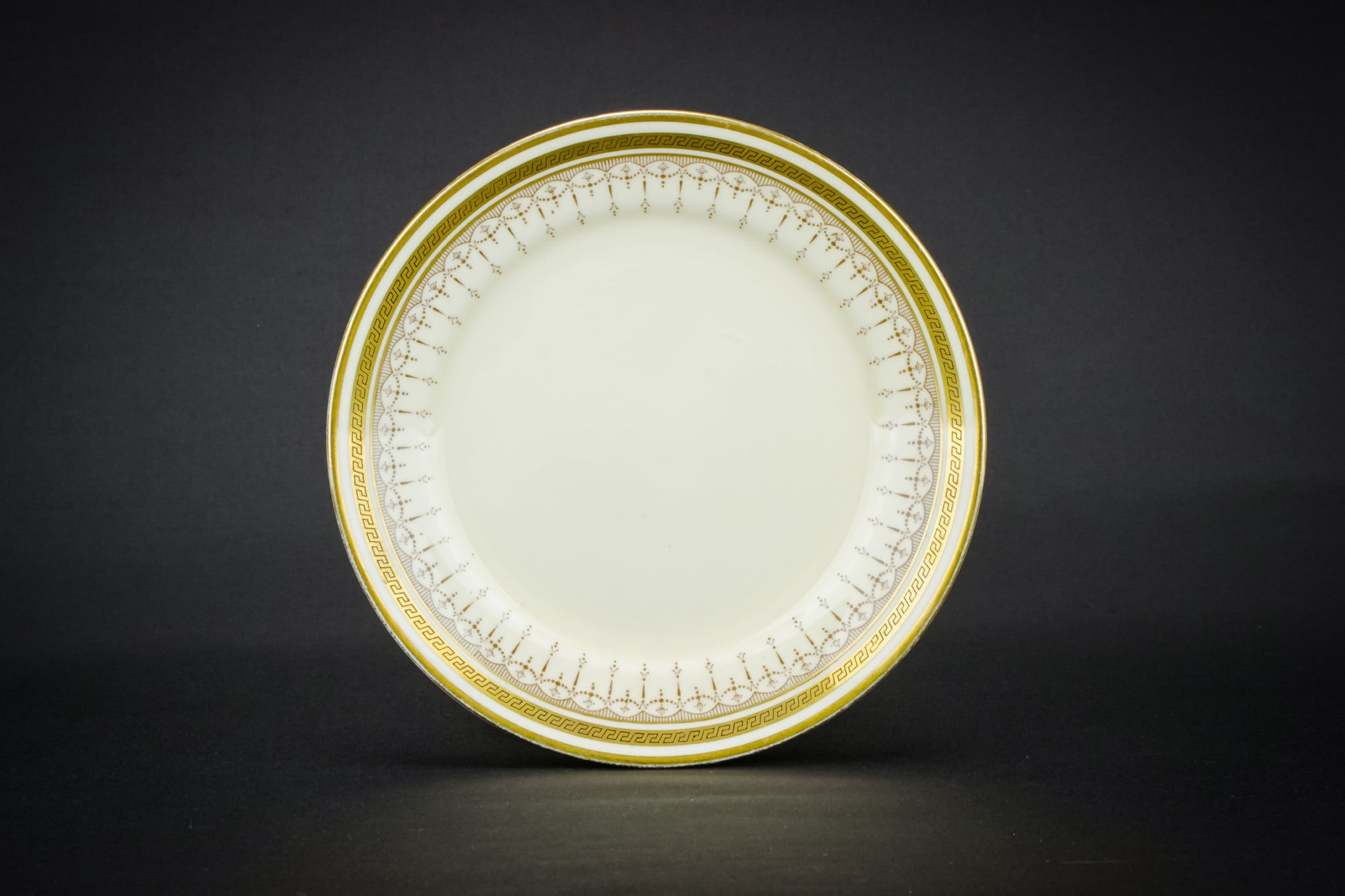 6 small gold plates