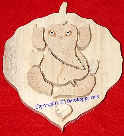 Auspicious Peepal Ganesha carved out of sacred Shriparni wood - Devshoppe