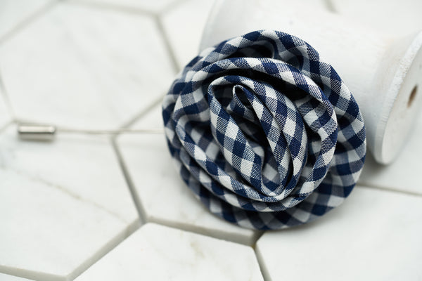 A front image of the stylish gingham flower lapel pin by Dear Martian, Brooklyn.