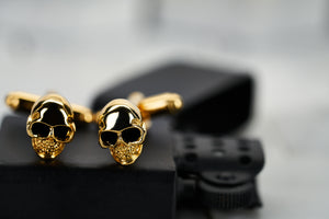 A front view image the gold plated skull men's cufflinks made by Dear Martian, Brooklyn.