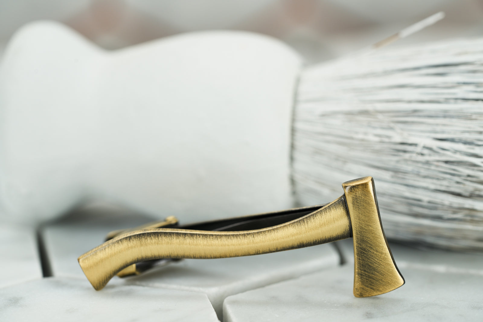 A side angle of the Dear Martian, Brooklyn, vintage brass ax tie clip.