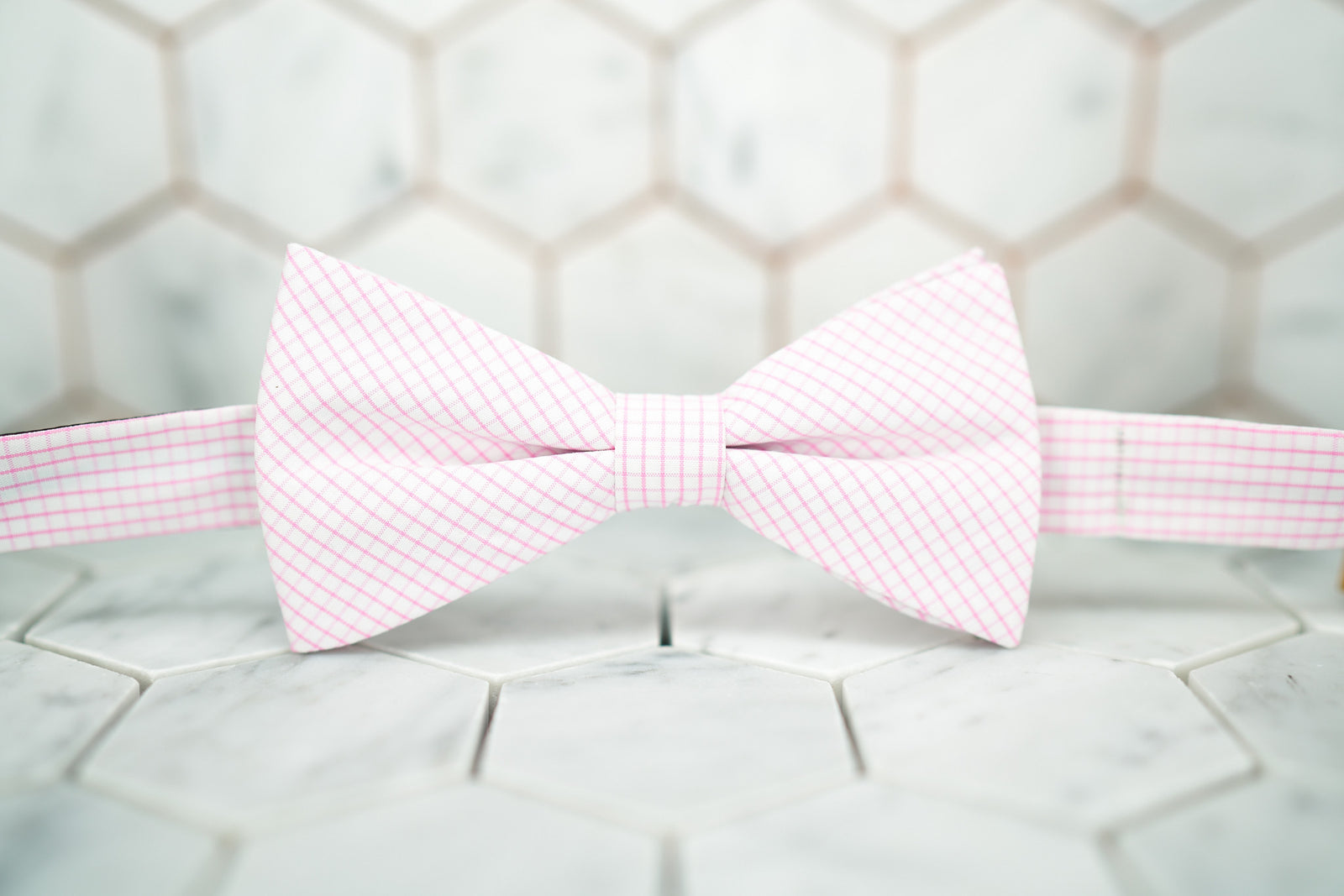 Front view of the pink windowpane bow tie made by Dear Martian, Brooklyn.