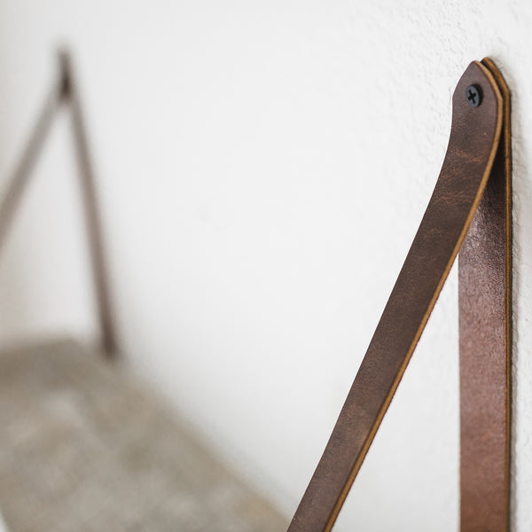 Detail of leather strap shelf.