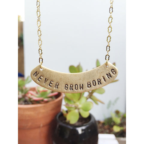 """NEVER GROW BORING"" GOLD NECKLACE"