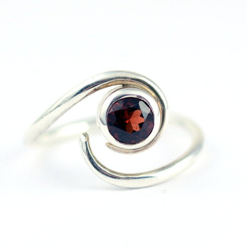 garnet swirl ring in sterling silver.