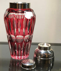 A CRANBERRY GLASS COCKTAIL SHAKER WITH SILVER PLATE