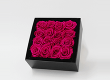 Stunning bright pink infinity roses, beautifully presented in a black box