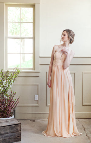 strapless a-line bridesmaid gown for a modern wedding, with bodice pleating.