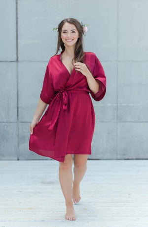 bridesmaid wearing burgundy bridesmaid robe