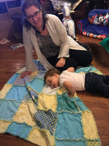 Grandma with Grand baby and quilt