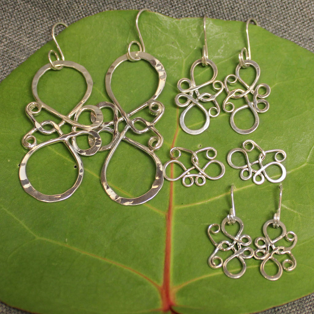 Small and large sterling silver butterfly earrings.