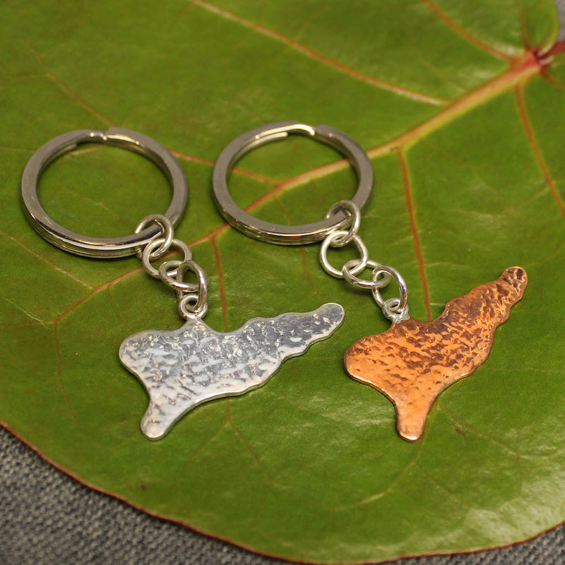 Hammered copper and sterling silver keychains shaped like the map of St.Croix.