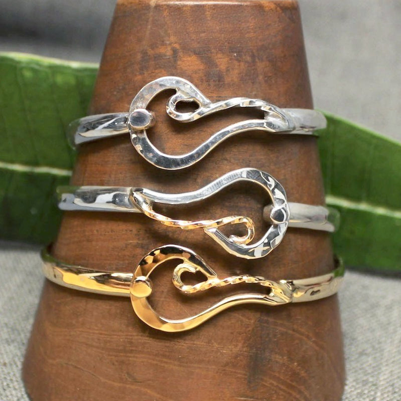 14k gold, Sterling silver and 14k gold with sterling silver classic bracelets with fire design.