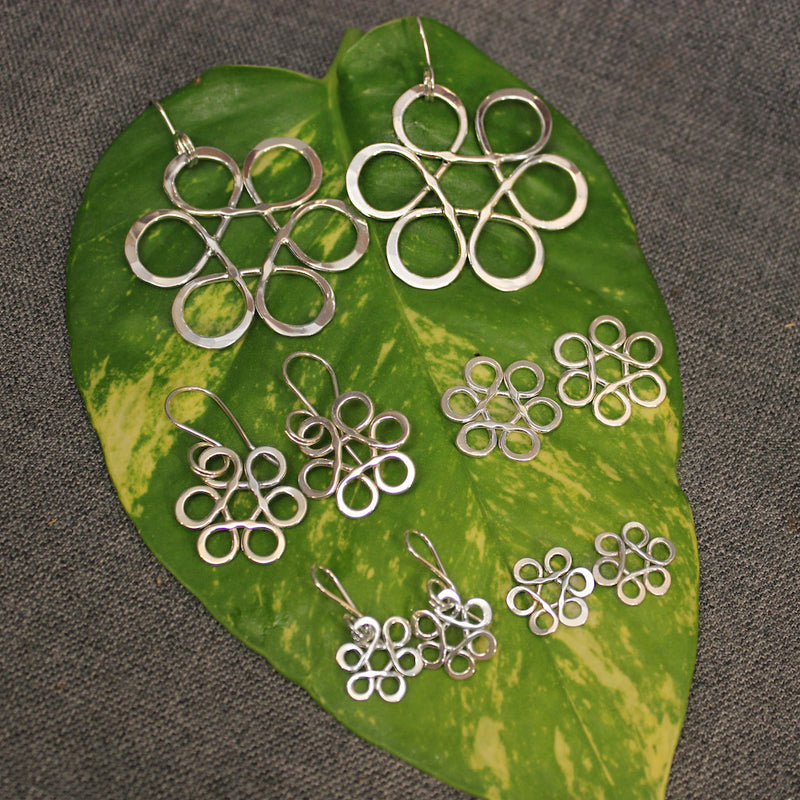 Small, medium and large sized sterling silver flower of life earrings.